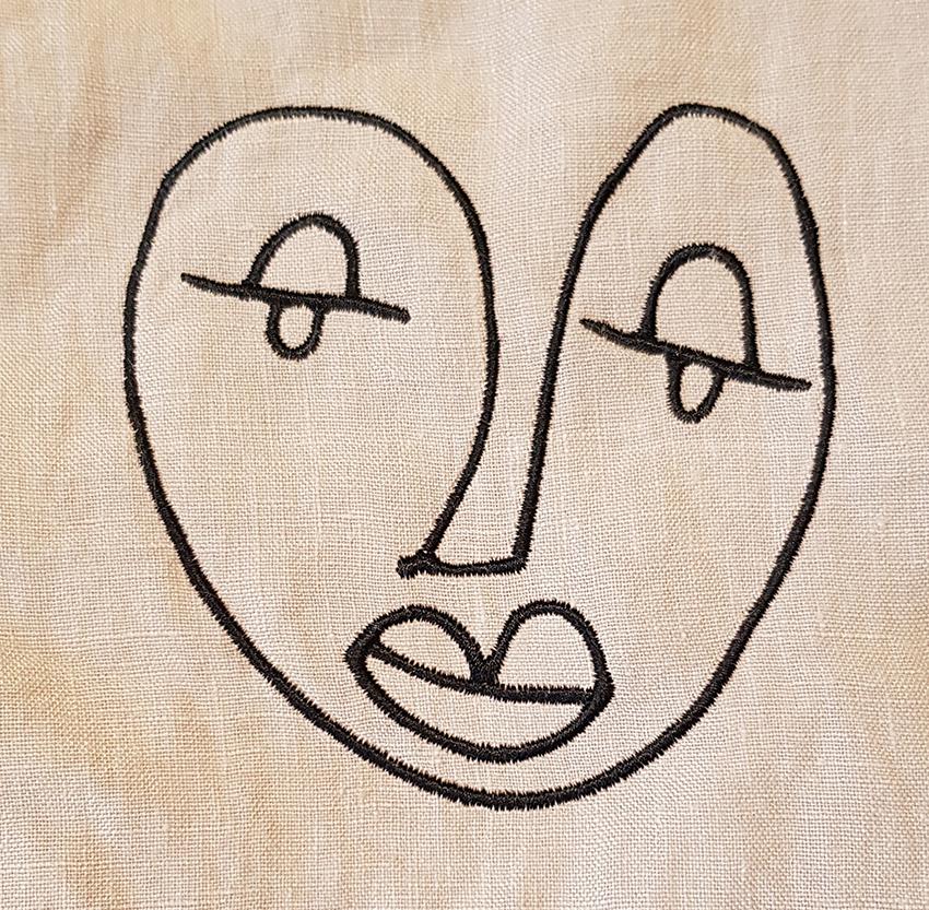 Borduring kussensloop Face